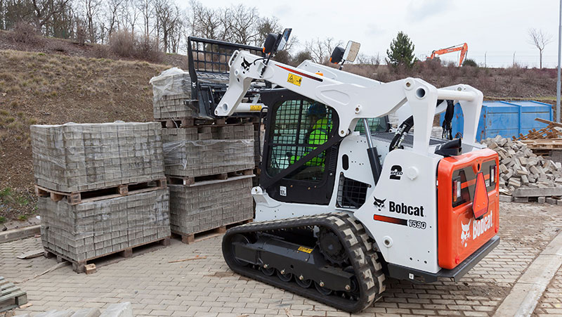 Compact track loaders can be used to transport heavy loads on-site, thanks to increased stability and low ground pressure.
